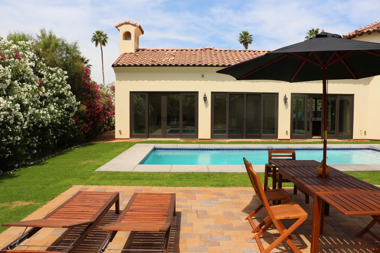 spanish colonial house and pool, ikea patio furniture, ikea chaise lounge,