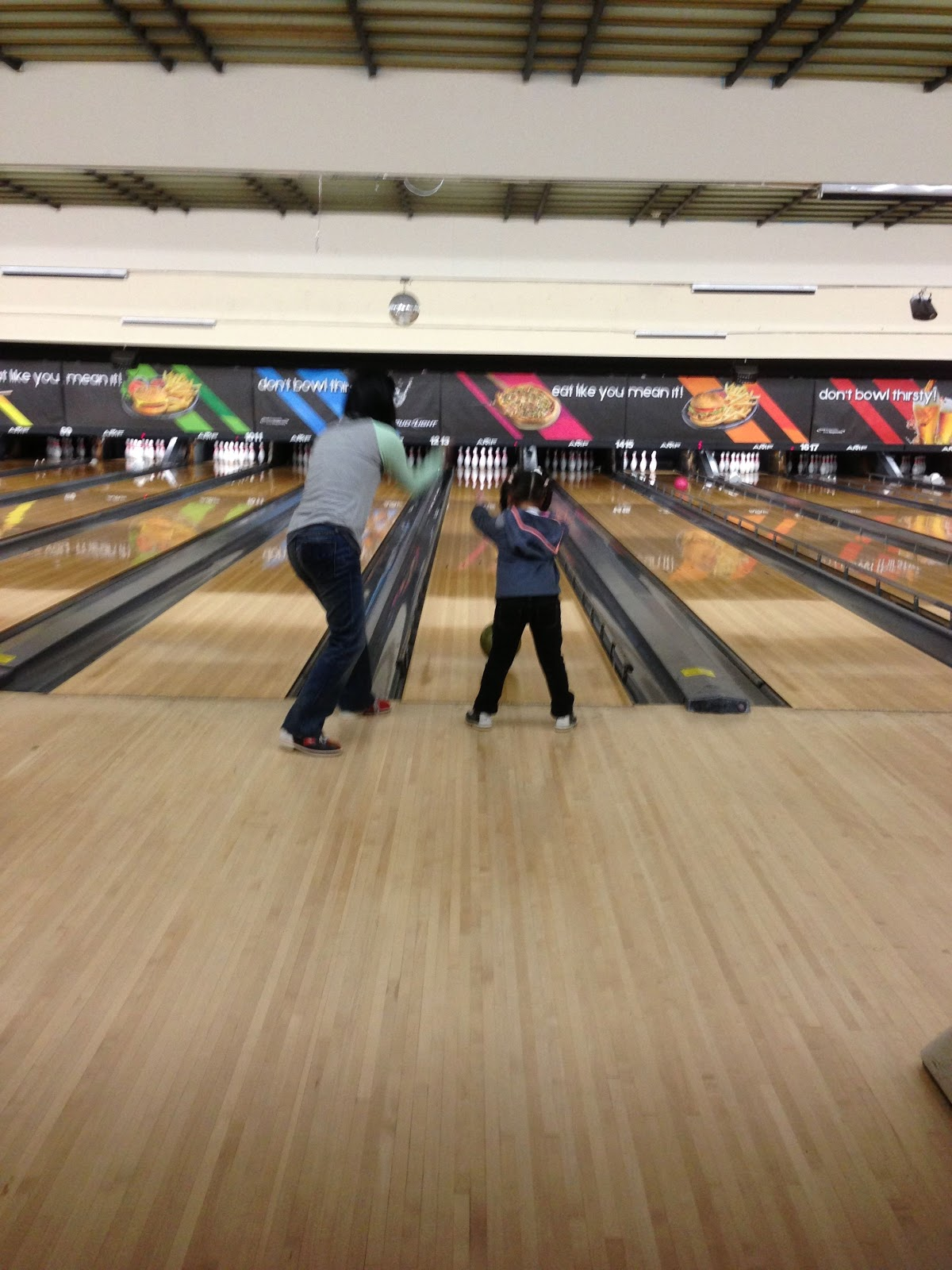 with the bumpers in place i helped her take the ball down the lane to bowl her very first frame
