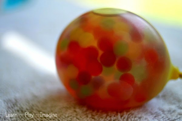 frozen water beads in water balloons learn play imagine