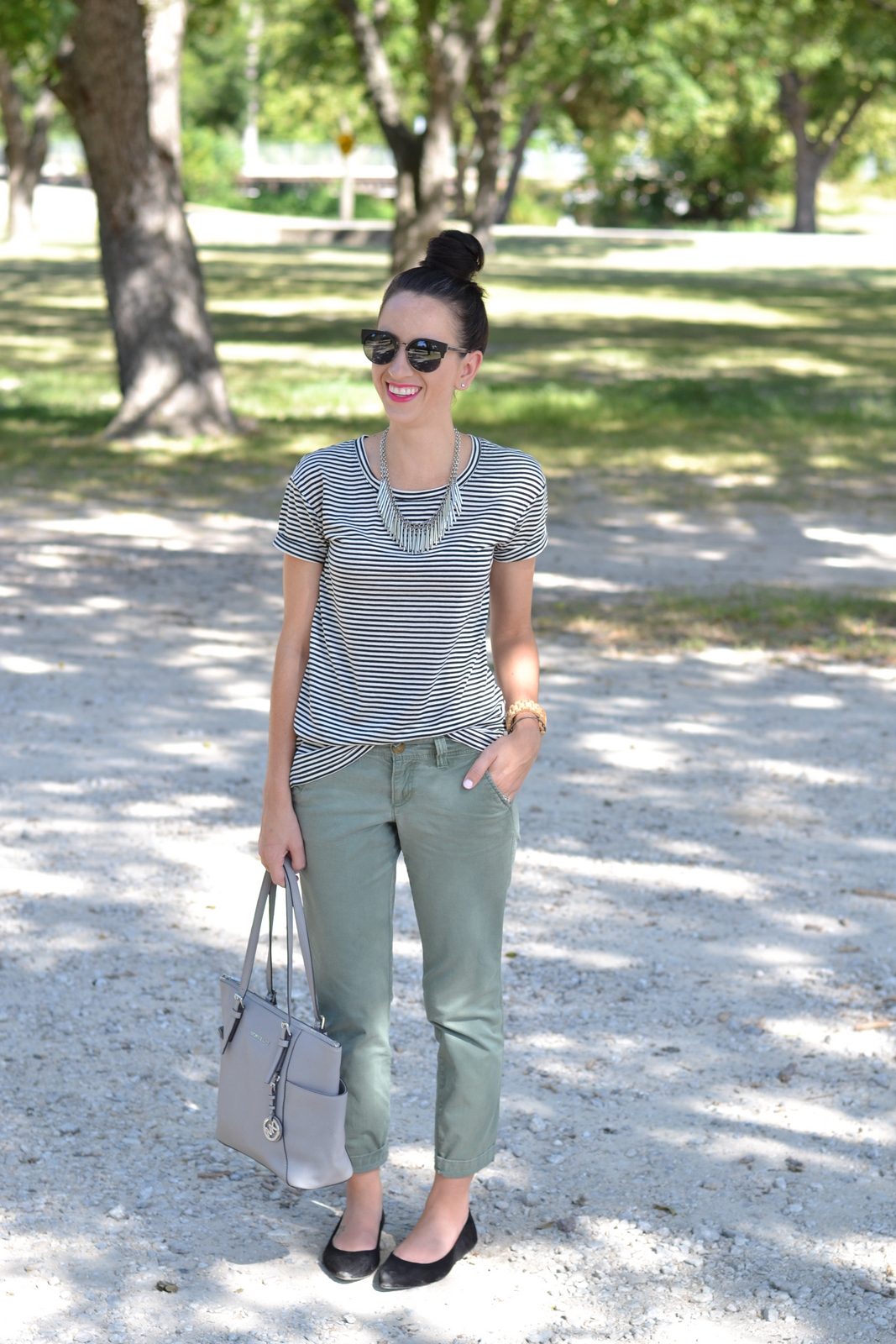 Striped Tee paired with cargo pants and pink lip