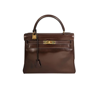 Vintage 1960's dark brown Hermes Kelly bag with gold hardware.