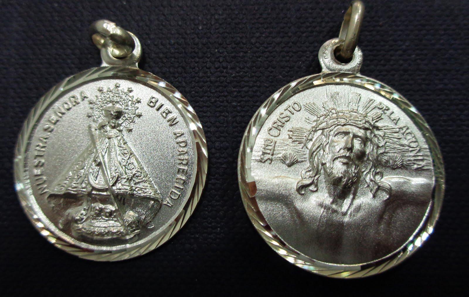 Medalla de plata con la Virgen Bien Aparecida, la otra cara lisa para poder grabar. 2,4 cm . 33€