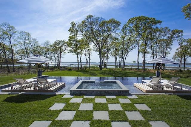 Infinity pool floating decks backyard Sag Harbor home