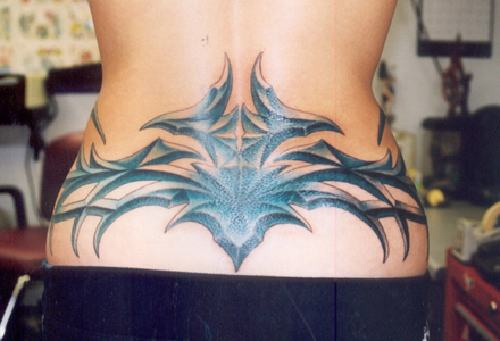 Big and black tribal tattoo on lower back