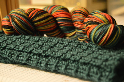 on the needles, fingerless gloves for a gift for Amber and yarn from Knit Knot Studios.
