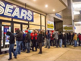 Sears black friday line day after Thanksgiving mall long lines customers waiting door busters