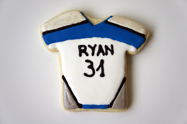 Custom hockey themed, jersey, ice skate, hockey stick and puck, logo, hand decorated sugar cookies, by Askanam. Find me on Etsy to order your custom cookies!