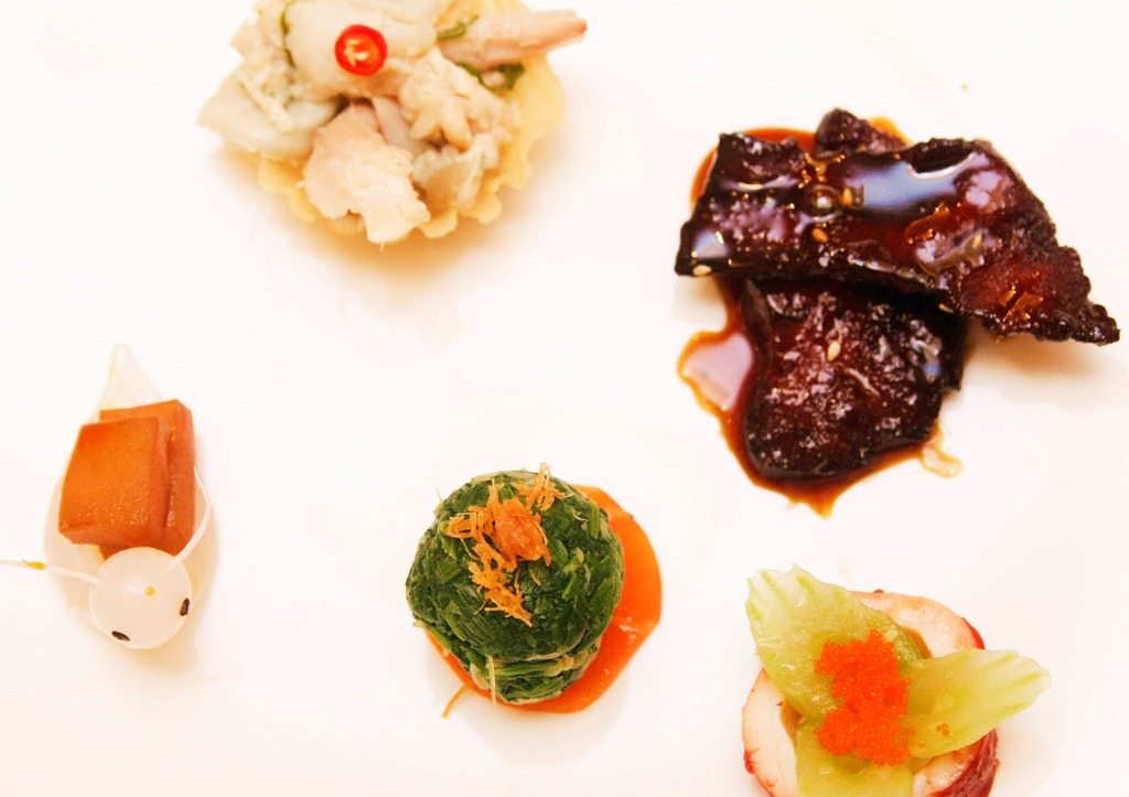 Stewed Snail with Garlic and Chili Sauce, Spinach with Green Mustard, Marinated Cuttlefish and Japanese Bean Curd, Marinated Chicken and Sliced Abalone with Wasabi, and Deep-Fried Fish with Five Spices.