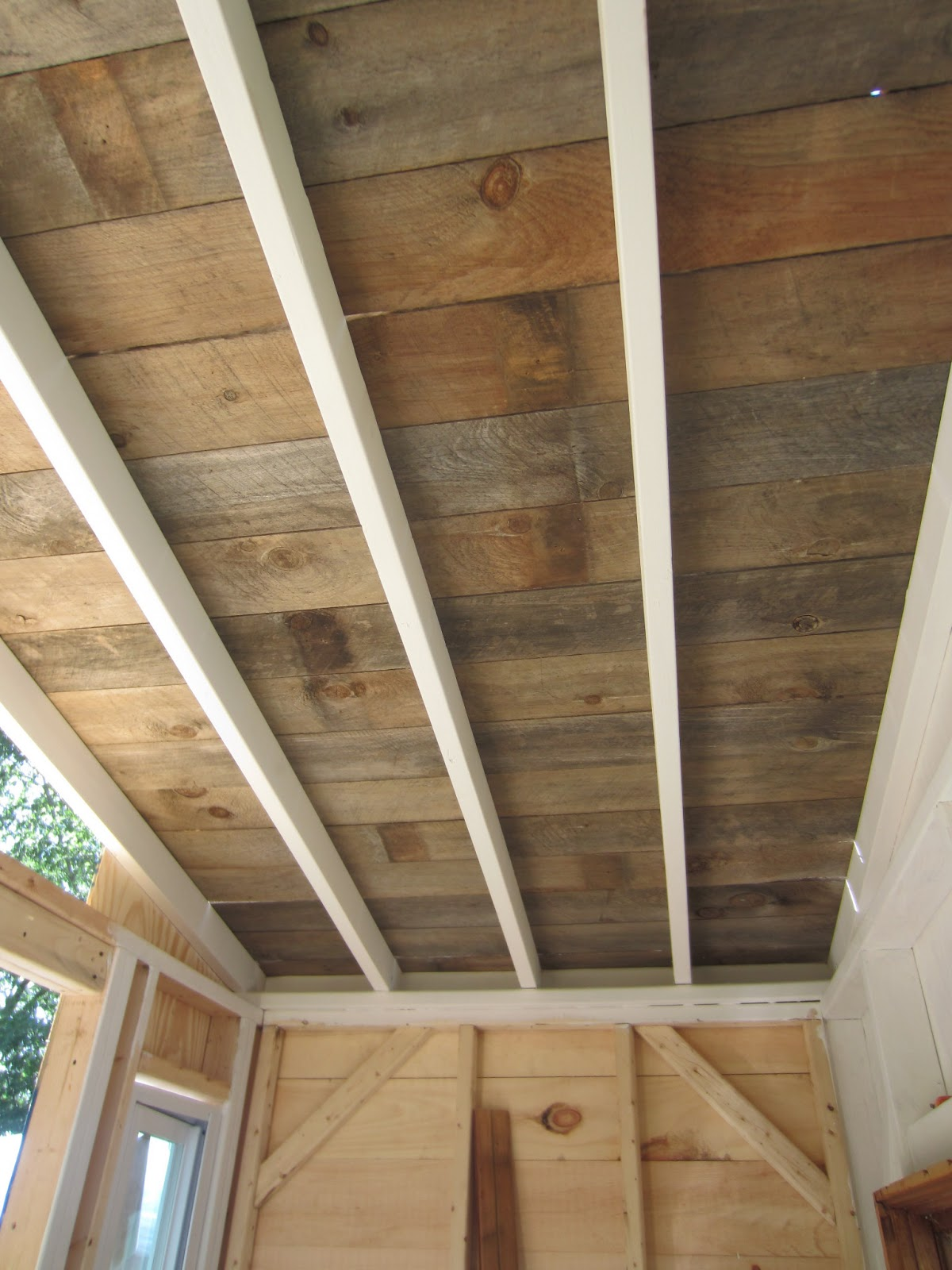 Relaxshacks A recycled barn wood fence plank ceiling in a tiny