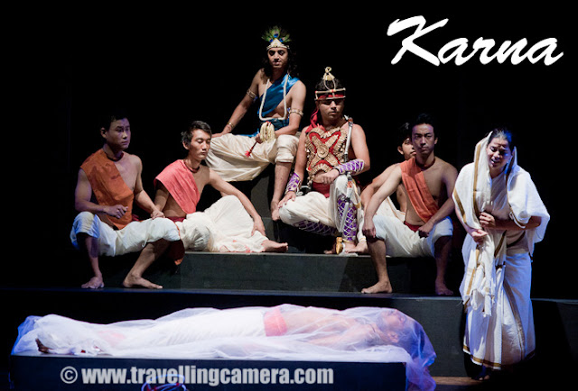 KARNA - A Theater play by second year students of National School of Drama !!! (24th to 29th May 2011) : Posted by VJ SHARMA on www.travellingcamera.com : Last month (May 2011), Second year students of National School of Drama performed a play called Karna in Abhimanch Auditorium. Here are some photographs form this play with some description about the play !!! This is a play about the life of Karna who is an important character in Mahabharata !!! Play starts with the childhood of Karana and then becoming a Yudha with all appropriate things !!!This play had wonderful lighting and Music !!!Some of the characters of Karna Play singing a beautiful song during the beginning of this play !!! Some of them plays the role of Pandvas, their mother and other shoodr girls from the village...Karna, getting ready for Yudh with Arjun !!!This play held at Abhimanch Auditorium, National School of Drama ( NSD ), Bahawalpur House , 1 Bhagwandas Road, New Delhi-110001Girl carrying a metallic pot to bring water for Karna afterhe gets ready for 'yudh-bhoomi'Karna taking all the good wishes from him mother, before going for 'yudh' with Aruna...Karna in surprized to see Arjuna attacking him while we requested to pause for some time, so that he could pull out the wheel of his 'Rath'  and place it in appropriate position...Krishna was continuously talking to Arjuna and motivating him to not stop and continue towards the win !When Karna dies in the war, play starts talking about various 'Shraps' he had got during his life...Here is Kunti explaining about the incident which caused the birth of Karna and explaning to her sons that he was their elder brother.After death, there was a confusion about the final ceremonies - who will do it ? Shoodr family, who took care of Karna all through his life from childhood or the original mother? Kunti took his dead body and the shoodr village continued with their local ceremonies...A wonderful play with amazing lighting and sound !!! The music used between various scenes was wonderful !!!