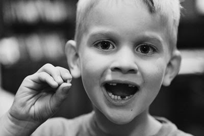 'Little dude' with his latest loose tooth from http://www.vintonville.com/little-dude/toothless/