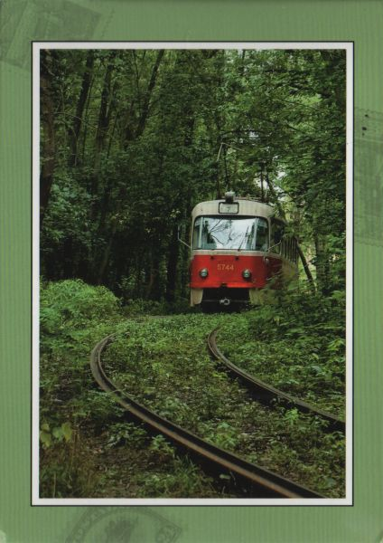 postcard of a tram or train going through woods