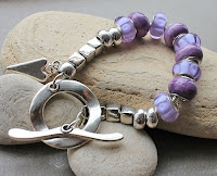 Pandora style bracelet in purple and silver