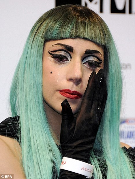 An emotional Lady Gaga wipes away tears as she remembers Japanese earthquake victims