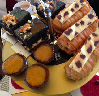 Salted caramel eclairs and other cakes at Rock and Roll Remix afternoon tea