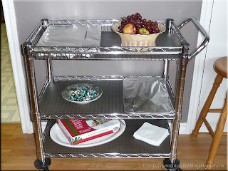 serving cart loaded with Christmas goodies in the games room