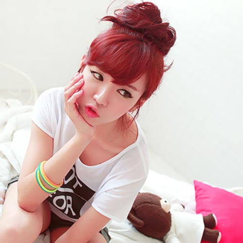 Korean Girl with red bun with Bangs Hairstyle