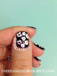 navy floral daisies nails