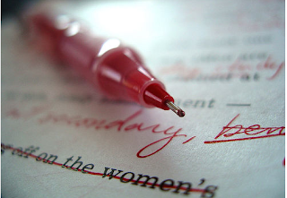 A red pen editing a paper.