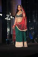 Bollywood and Tollywood acress Amisha, Patel, bridal look, hot sexy, wedding, reception, green choli and lehenga