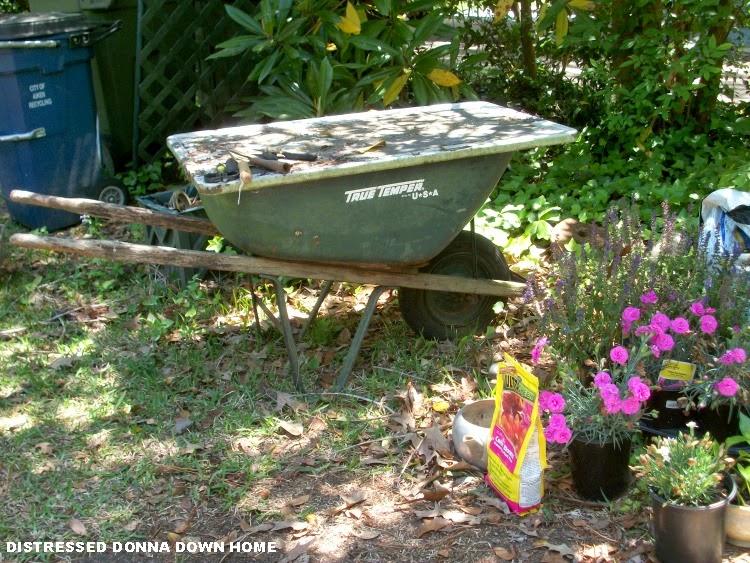 Upcycled wheelbarrow, gardening, potting bench