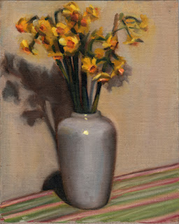 Oil painting of a bunch of jonquils in a white vase on a striped tea towel.