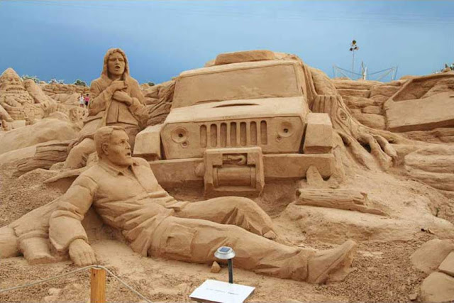 foto escultura  na areia