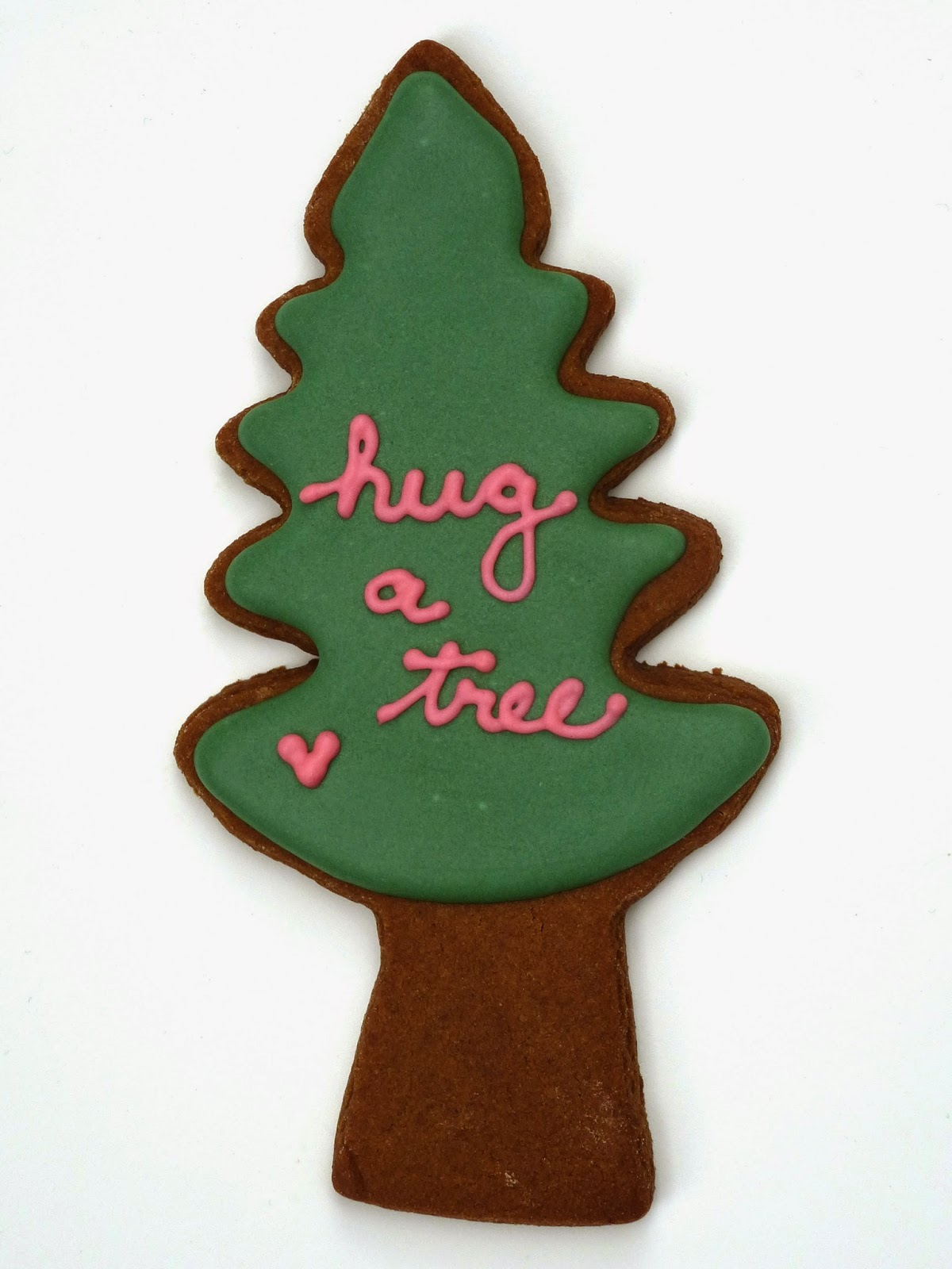 "Decorated Cookie says ""hug a tree"""