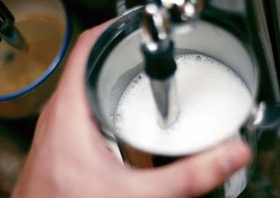 coffee barista frothing milk