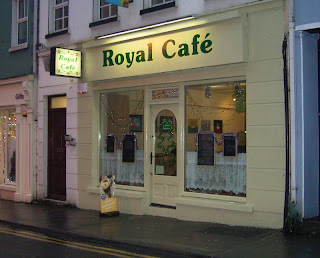 Winter-time photo of Royal Cafe Galway, Ireland:  looks inviting with bright lights on a dull day.