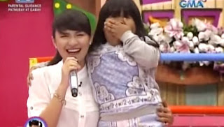Gerphil and Ryzza Mae while singing.
