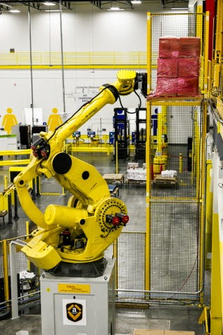 Amazon's Robo-Stow, one of Earth's largest robotic arms moving products directly to a Kiva robot in its newest generation fulfillment center