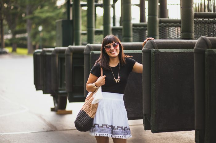 black tee & white tassel skirt with gold accessories