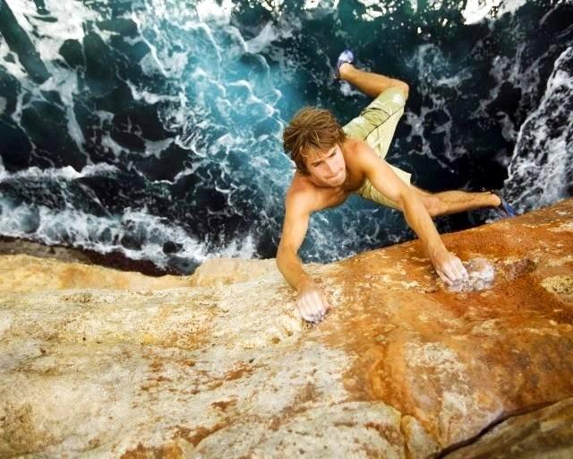 Adrenaline Junkies hanging on Rock