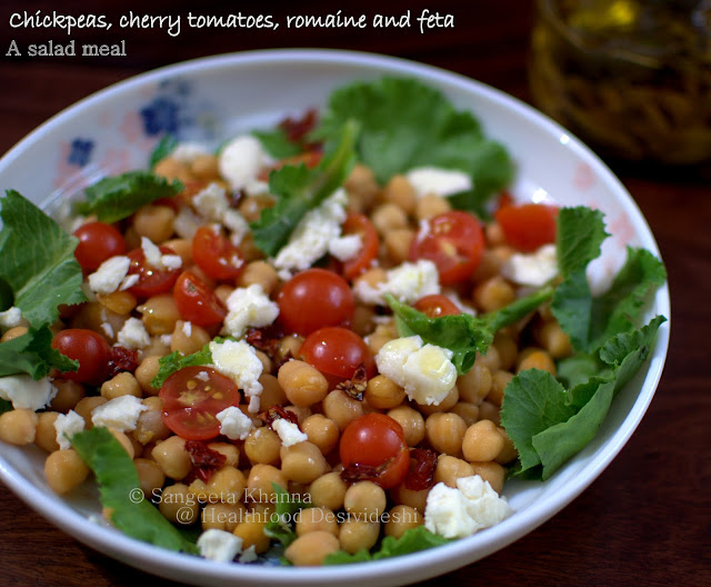 chickpeas, cherry tomatoes and feta salad with garlic and rosemary infused olive oil : a quick spring salad is suitable for the scorching heat we are living in…