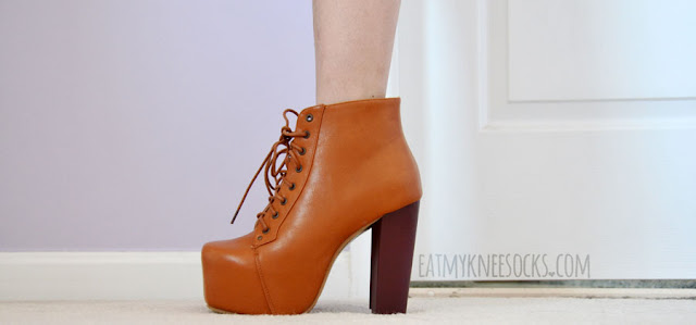 Milanoo's Jeffrey Campbell Lita platform booties dupes are made of a smooth, shiny faux-leather material and a wooden heel, with a lace-up front.