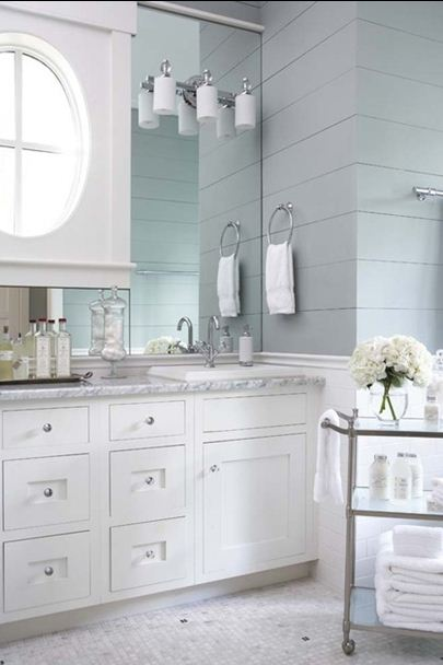 white vanity marble gray wood paneled walls
