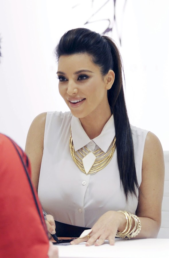 KIM KARDASHIAN  sinning some autographs at Belle Noel Jewelry Collection Promotion in Toronto