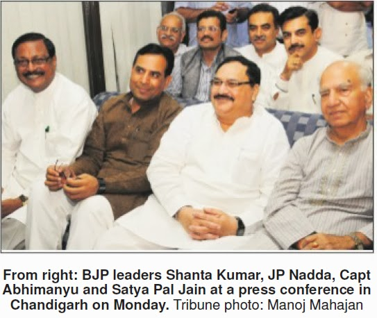 BJP leaders Shanta Kumar, JP Nadda, Capt Abhimanyu and Satya Pal Jain at a press conference in Chandigarh on Monday. Tribune photo: Manoj Mahajan