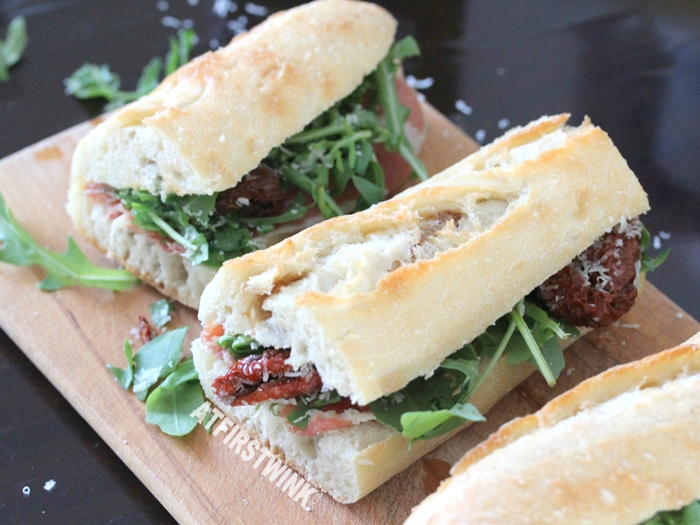 recipe: baquette with serrano ham, sun-dried tomatoes, peccorino, and rocket lettuce