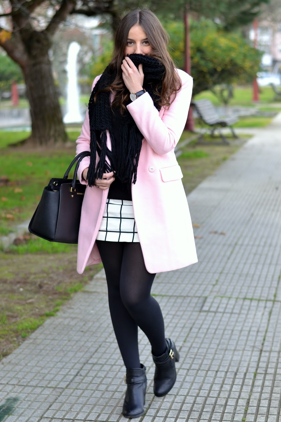pink coat with black and white