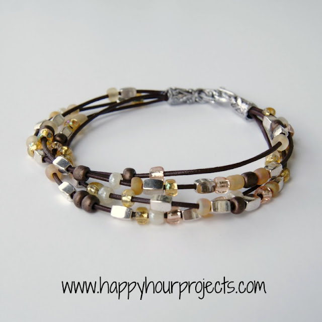 little bracelet from leather cord and small beads mainly seed beads