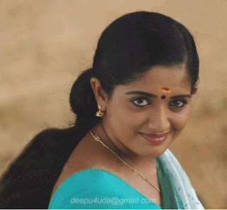 Kavya Madhavan smiling