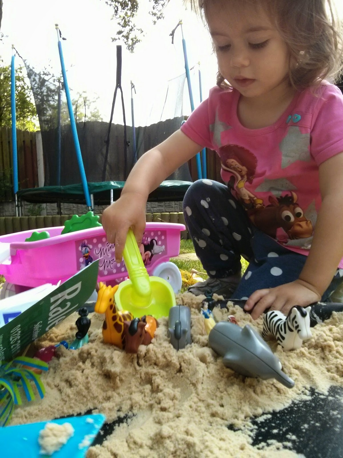 Using sand for messy play
