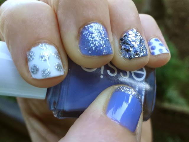Blue nail polish with silver glitter, white polish with polka dots