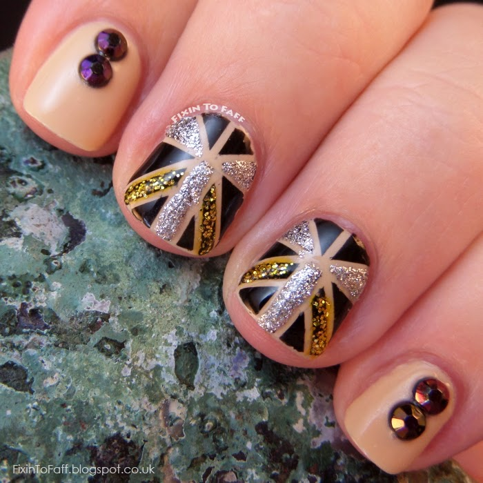 Art Deco inspired nail art using striping tape, glitter, and rhinestones.