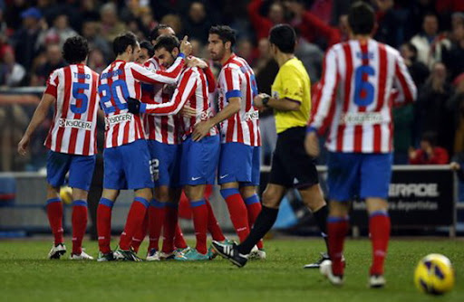 Atlético Madrid player Adrián celebrates his goal against Celta Vigo with his teammates