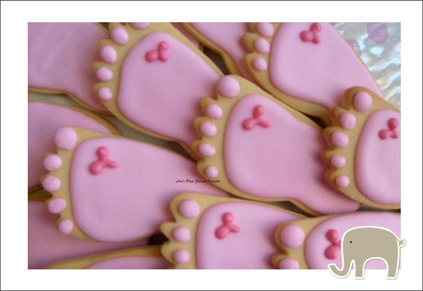These sugar cookies are in the shape of a tiny foot. You can buy these ...
