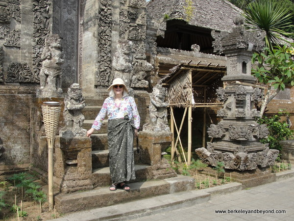 visitor in sarong at Penglipuran Traditional Village temple in Bali