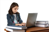 This image shows a little girl blogging which explains the kids blogging in C4Ks